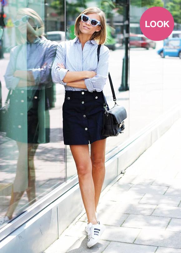 Tenue avec des Adidas Superstar blanches et une jupe